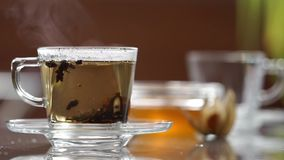 Transparent cup of tea on the table. A cup of tea on the table stock video