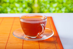 Transparent cup with tea on table Stock Image