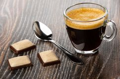 Free Transparent Cup With Coffee Espresso, Pieces Of Chocolate, Spoon On Wooden Table Stock Images - 143635354