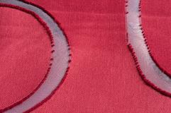 Transparent curves. In red burnout fabric Stock Images