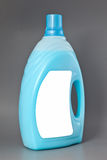 Transparent detergent plastic bottle isolated on gray Stock Images
