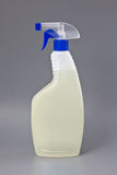 Transparent detergent plastic spray bottle isolated on gray Stock Image