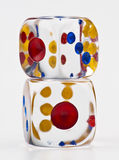 Transparent dice. Transparent acrylic dice white with colored dots on white base Stock Photos
