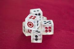 Transparent dice on a red felt. Six transparent dice on a red felt Stock Image