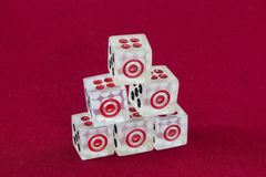Transparent dice on a red felt Royalty Free Stock Image