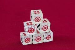 Transparent dice on a red felt. Six transparent dice on a red felt Royalty Free Stock Image