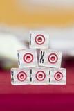 Transparent dice on a red felt. Six transparent dice on a red felt Stock Images
