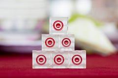 Transparent dice on a red felt. Six transparent dice on a red felt Stock Photos