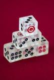 Transparent dice on a red felt. Six transparent dice on a red felt Stock Photo