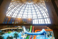 The dome of the water park in St. Petersburg, permeable to ultra. Transparent dome of water park, pools and slides for launching in water Royalty Free Stock Photos