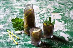 Transparent drink in a glass. With chia seeds, lemon and mint on a wooden background. Selective focus Royalty Free Stock Photo