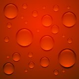 Transparent drop on red surface, background Royalty Free Stock Photos