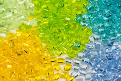 Transparent dyed plastic granulates Royalty Free Stock Images