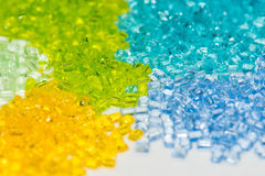Transparent dyed plastic granulates Royalty Free Stock Photo