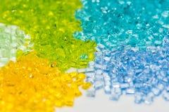Transparent dyed plastic granulates royalty free stock photo