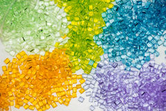 Transparent dyed plastic granulates Stock Images