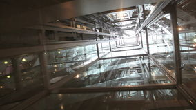 Transparent Elevator Ride. Ride in a transparent glass elevator going up stock video footage