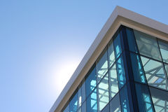 Transparent facade of the building against the sky and the s Royalty Free Stock Photo