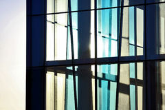 Transparent facade of the building against the sky and the s Royalty Free Stock Image