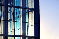 Transparent facade of the building against the sky and the s Royalty Free Stock Images