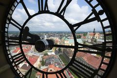 Transparent face of clock. Top view of the old town of Przemysl taken from cathedral tower through transparent face of clock, Poland Stock Images