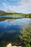 Transparent fjord with green shore. Royalty Free Stock Photos