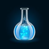 Transparent flask with magic blue liquid on black Stock Photos