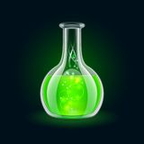 Transparent flask with magic green liquid on black Stock Images