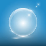 Transparent glass ball on blue background Stock Images