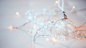 Transparent glass ball. Christmas toy. among the glittering lanterns, a garland. Royalty Free Stock Photography