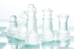 Transparent glass chess. On mirror board Stock Image