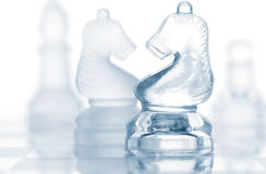 Transparent glass chess pieces Royalty Free Stock Images