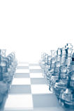 Transparent glass chess pieces. Is standing in row Stock Photo