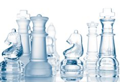 Transparent glass chess pieces Royalty Free Stock Photo