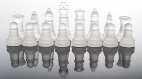 Transparent glass chess pieces with reflection Stock Image