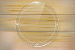 Transparent glass circle frame on wooden background Royalty Free Stock Image