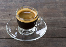 Transparent glass cup of coffee. On top of wood table Stock Photography