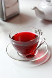 Transparent glass cup of red fruit tea on the Royalty Free Stock Images