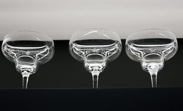 Transparent glass dishes and jars on shelves. Transparent glass dishes, glasses and cans on the shelves are rows Stock Photo