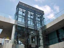 Transparent glass elevator Stock Image