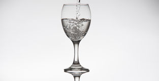 Transparent glass fill with water Royalty Free Stock Images
