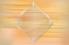 Transparent glass frame on wooden background Royalty Free Stock Photos