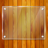 Transparent glass frame on wooden background Stock Photos
