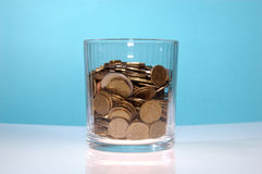 Transparent glass fulfilled of money Royalty Free Stock Image