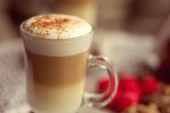 Transparent glass with latte in cafe Stock Photos