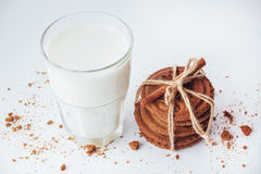 Transparent glass of milk and cookies on a white background Royalty Free Stock Photography