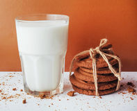 Transparent glass of milk and cookies on a white background Royalty Free Stock Images