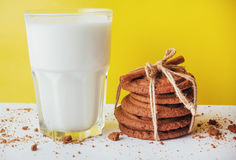 Transparent glass of milk and cookies on a white background Royalty Free Stock Photos
