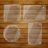 Transparent glass plates on wooden planks Royalty Free Stock Photo