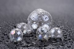 Transparent glass sphere with water drops isolated on black. Background Royalty Free Stock Photos